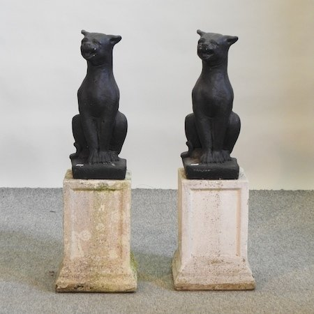 Lot 6,   A pair of black painted reconstituted stone models of cats, each on a pedestal base, 86cm high  120/180