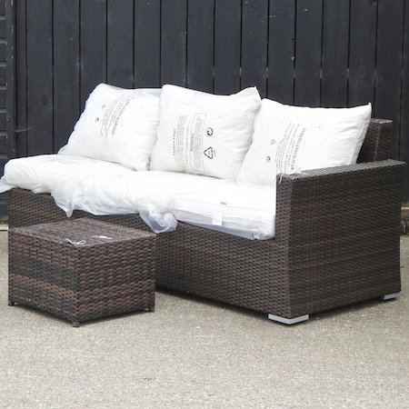 Lot 10,   A brown rattan three seater sofa, 200cm, with loose cushions, together with a matching coffee table 120/160