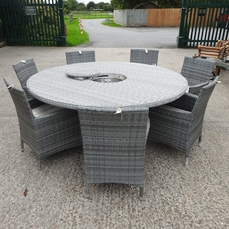 Lot 12,   A grey rattan circular garden table, fitted with an ice bucket, together with a set of seven garden armchairs 200/300