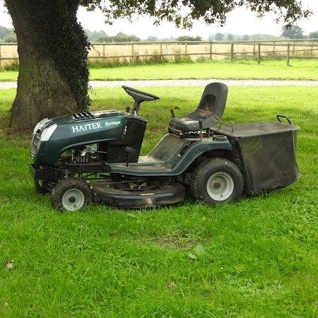 Lot 14,   A green Hayter petrol driven ride on lawnmower 300/500