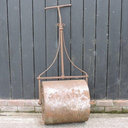 Lot 16,   An antique cast iron garden roller, 63cm wide 30/40