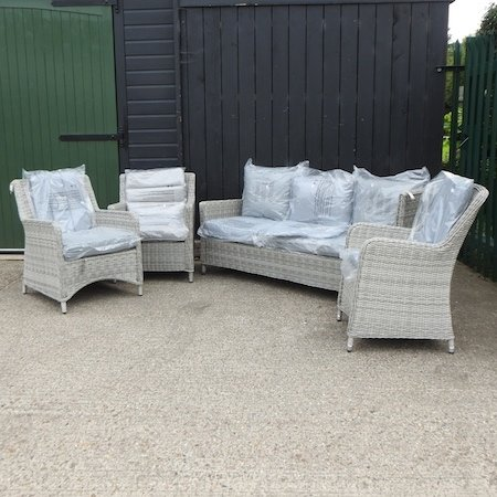 Lot 20,   A grey rattan three seater sofa, 182cm, together with three armchairs, with loose cushions 150/250