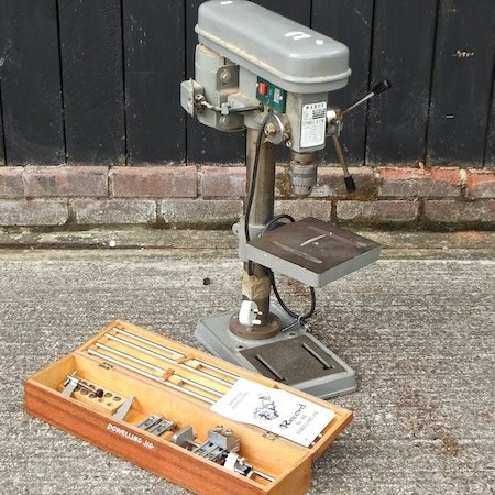 Lot 38,   A Warco bench pillar drill, together with a Record dowelling jug, boxed 40/60