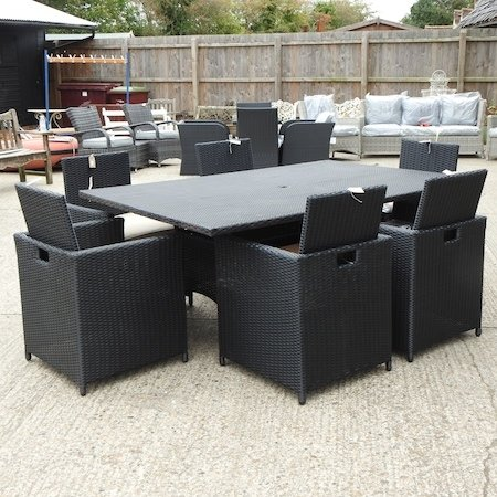 Lot 39,   A large rattan rectangular garden table, 190 x 125cm, together with a set of six matching cube dining chairs  180/220