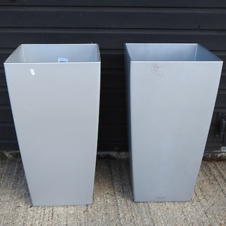 Lot 48,   A pair of large silver coloured garden pots, 75cm high 20/40