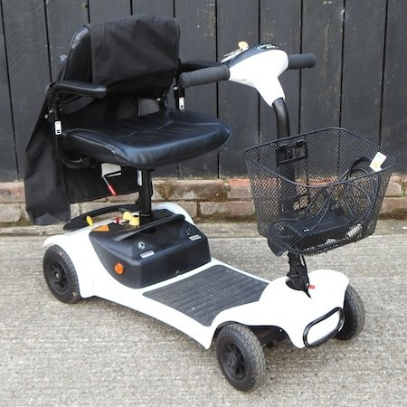 Lot 56,   A white Ultralite 480 electric mobility scooter 50/70