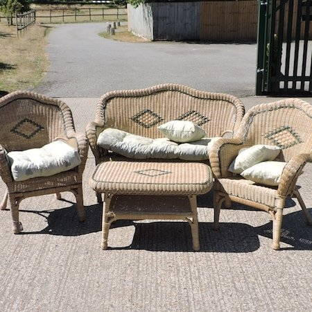Lot 59,   A rattan conservatory set, comprising of a sofa 130cm, two armchairs and a coffee table 30/40