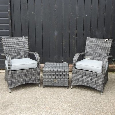 Lot 7,   A garden set, comprising a pair of armchairs, with loose cushions and a square coffee table, 48cm  50/70