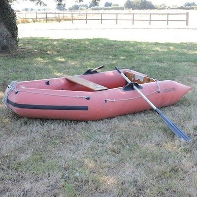 Lot 11,   An inflatable dinghy, with a wooden base, 290cm long 40/60