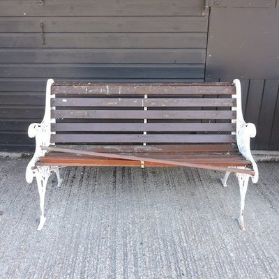 Lot 13,   A white painted metal and slatted wooden garden bench, 126cm 30/50