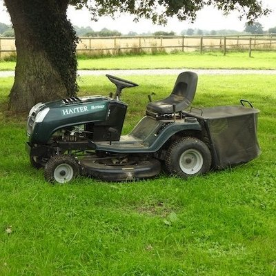 Lot 14,   A green Hayter petrol driven ride on lawnmower 300/500