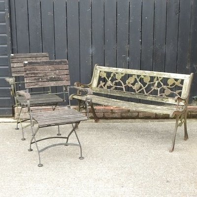 Lot 15,   A cast iron slatted garden bench, 126cm, together with a pair of folding garden chairs 30/40