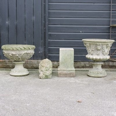 Lot 17,   A reconstituted stone urn, 58cm high, together with a reconstituted stone planter on a pedestal base, a reconstituted stone lion and a pedestal 40/60