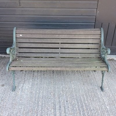 Lot 19,   A green painted metal and slatted wooden garden bench, 127cm 30/50