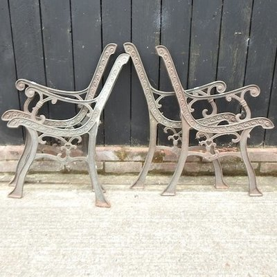 Lot 29,   A pair of cast iron bench ends, together with another pair 20/30