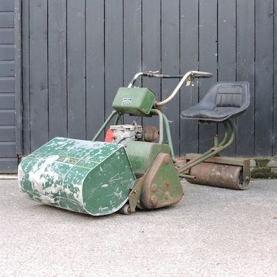 Lot 28,   A cylinder lawn mower, with a detachable seat 40/60