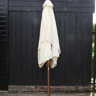 Lot 27,   A teak parasol, with cream canvas, 300 x 200cm overall 40/60