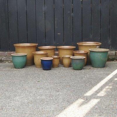 Lot 34,   A collection of glazed garden pots, largest 39cm diameter 30/40