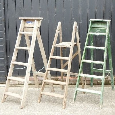 Lot 36,   A set of wooden steps, 146cm high, together with two others smaller 30/40