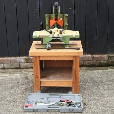 Lot 54,   An Orteguil mitre cutter, on a stand, together with a ratchet winch, boxed 50/70