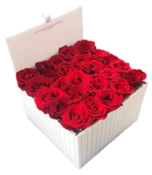 Large white box of roses