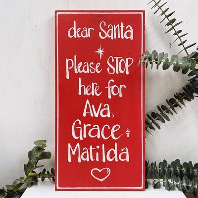 ...'Santa Stop Here' sign...