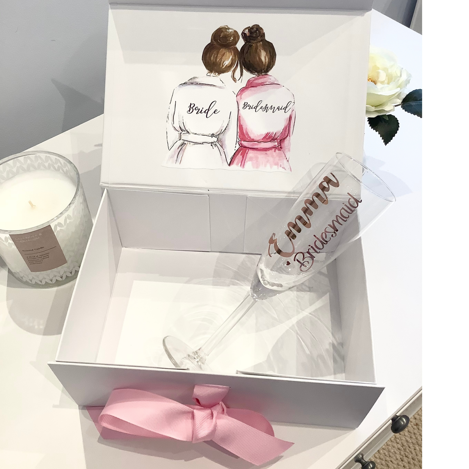 Bridesmaid picture ribbon tied gift box with champagne flute