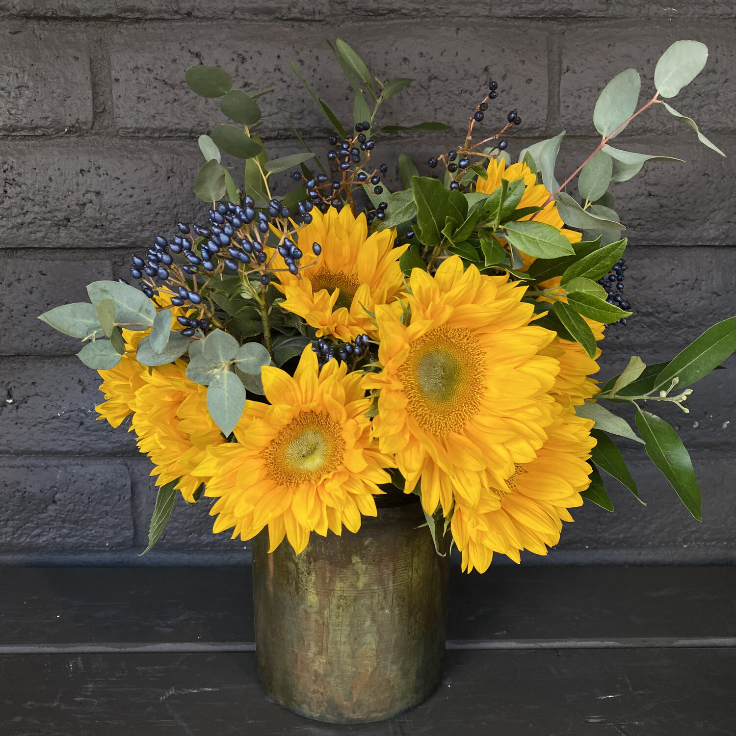 LOCAL SUNFLOWERS IN TIN POT