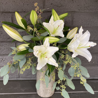 LOCAL LILIES IN CERAMIC VASE