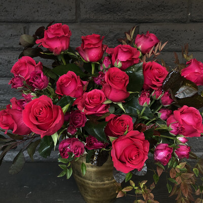 HOT PINK ROSES IN BRASS VASE