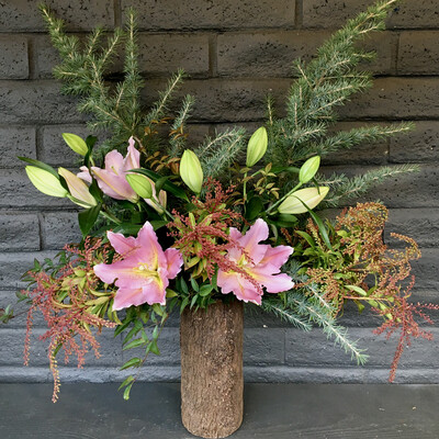 PINK LILIES IN TIMBER VASE
