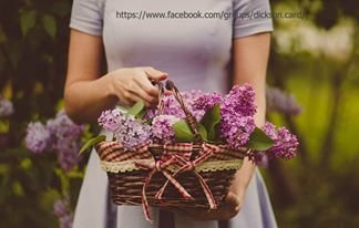 Basket with lilac in hand
