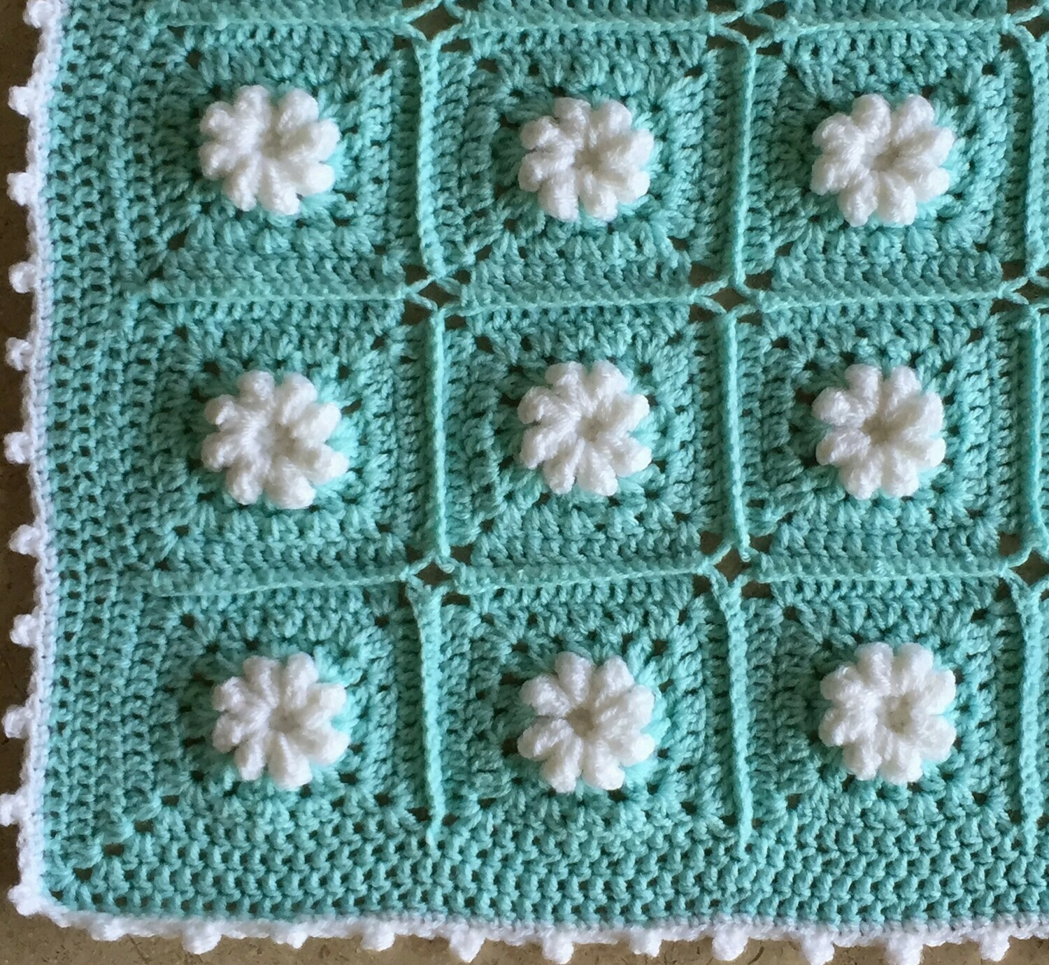 Baby blankets White flower in Turquoise square