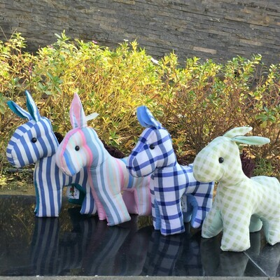Toy: donkey in checkered green and white