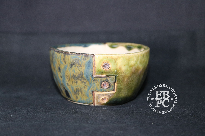 SOLD - SUTEKI - 8.6cm; Accent / mame; Industrial screw design; Round; Glazed; Light green; Blue; Browns; EBPC Dual Stamped Piece; Simon Haddon
