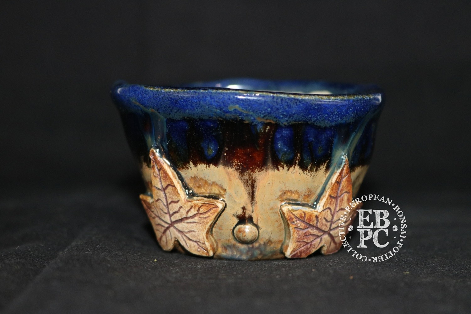 SUTEKI - 8.1cm; Accent / mame; Carved leaf design; Round; Glazed; Blue; Browns; EBPC Dual Stamped Piece; Simon Haddon