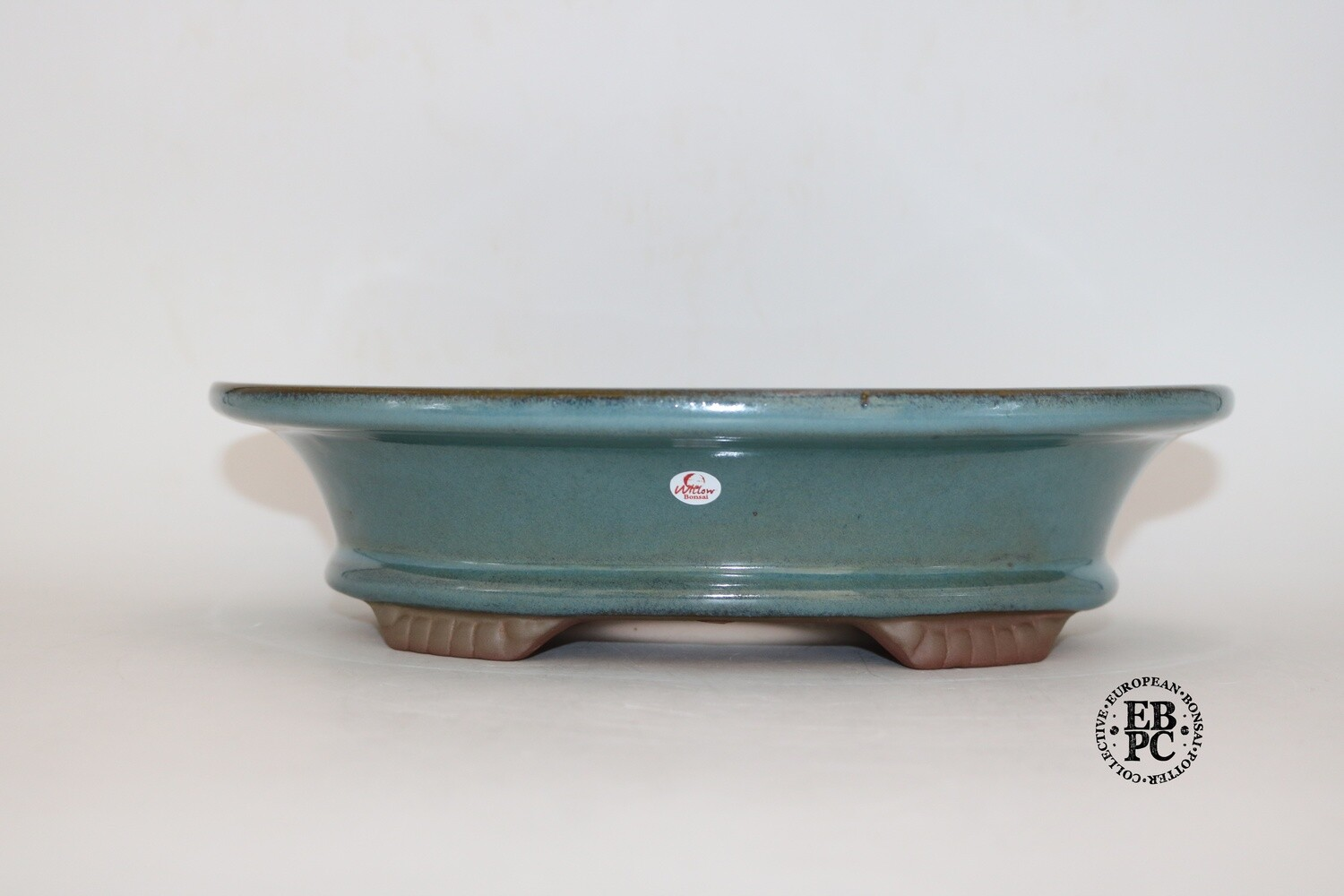 Willow Bonsai Pots, S.Africa -  Oval; Wide Lip Design; Teal Glaze; Greens, Browns, Blues; Scalloped Feet; EBPC stamped.