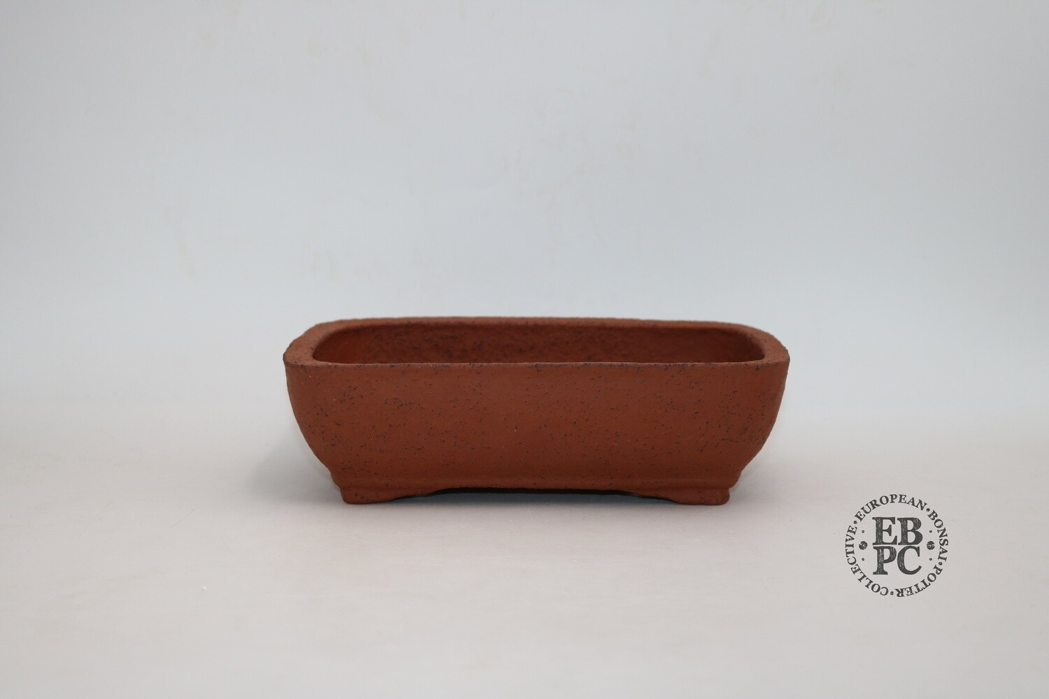 SOLD - Zey Ceramics - 24cm; Unglazed; Soft-Cornered Rectangle; Groggy Red/Brown Clay; Recessed feet; Basal Band