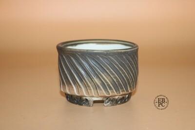 EBL Pots - 7.8cm; Porcelain; Shohin / Accent pot; Round; Olive Green; Peach; Carved Twist to the Body; Elsebeth Ludvigsen.