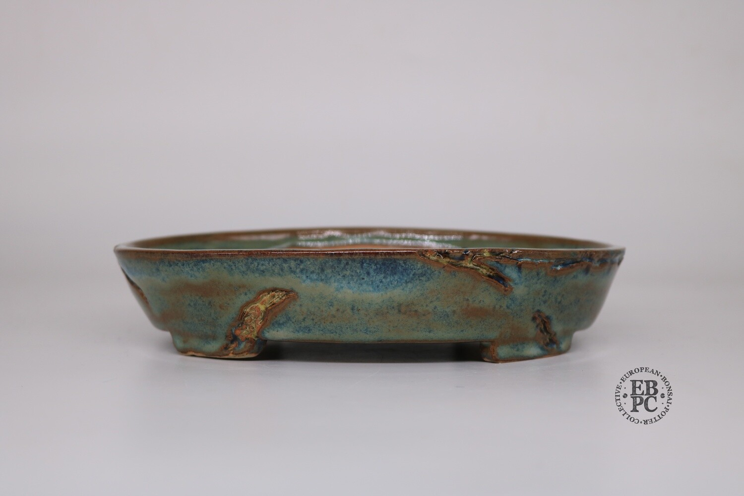 SOLD - Paul Rogers Ceramics - 20.3cm; Glazed; Oval; 'Mushikui' / Bug eaten Carved Detail; Blues; Greens; Browns; EBPC Stamped;