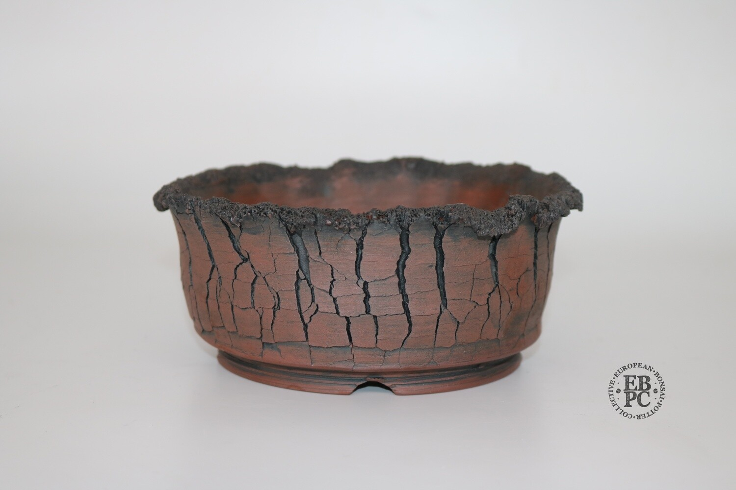 SOLD - Paul Rogers Ceramics - 17.2cm; Unglazed; Round; Crackle Finish; Decaying Lip Detail; Browns; Charcoal; EBPC Stamped;