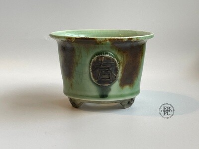 EBL Pots - 10.1cm; Porcelain; Shohin / Accent pot; Carved '春' (spring) Motif; Recssed Feet; Aged Blue & Brown Glaze; Elsebeth Ludwigsen