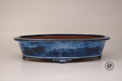 Fukurou Ceramics - Switzerland.   Hand-made; 31.2cm; Oval; Lip to Rim; Basal Band in Relief; Cloud Feet; Glazed; Namako-like Blue; Patrik Lüthi