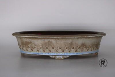 Fukurou Ceramics - Switzerland.  Hand-made; 30.6cm; Oval; Glazed; Formal Studs Design; Lip to Rim; Cloud Feet; Cream; Brown; Baby Blue; Patrik Lüthi.