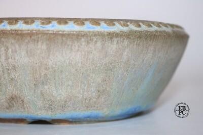 Fukurou Ceramics - Switzerland.  18cm; Round; Studs to Bevelled Rim; Foot Ring; Arch-cut Feet; Exquisite Glaze; Cream; Greens; Browns; Dynamic Sky Blue; Made by Patrik Lüthi.