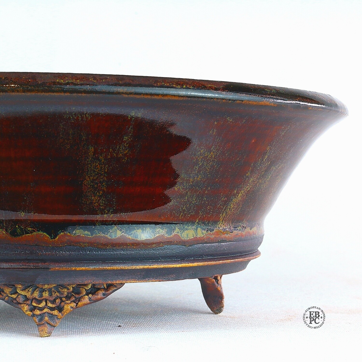 Kingdom Bonsai Pots - Ireland.  18.4cm; Round; Delicate Carved Feet; Exquisite Glaze; Blood Red; Yellows and Greens; EBPC Stamped; Enda Coyne