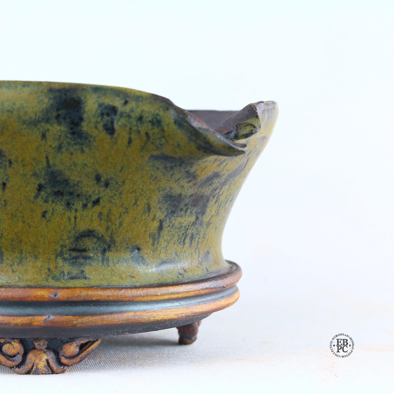 Kingdom Bonsai Pots - Ireland.  12.7cm; Round; Semi-Cascade; Banding in Relief; Carved Feet; Superb Glaze; Greens; Dark Blue; EBPC Stamped; Enda Coyne