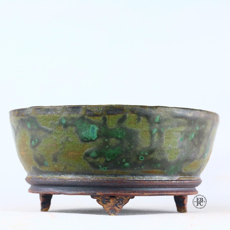 Kingdom Bonsai Pots - Ireland.  11.4cm; Round; Semi-Cascade; Banding in Relief; Carved Feet; Superb Glaze; Greens; Yellows; Browns; EBPC Stamped; Enda Coyne