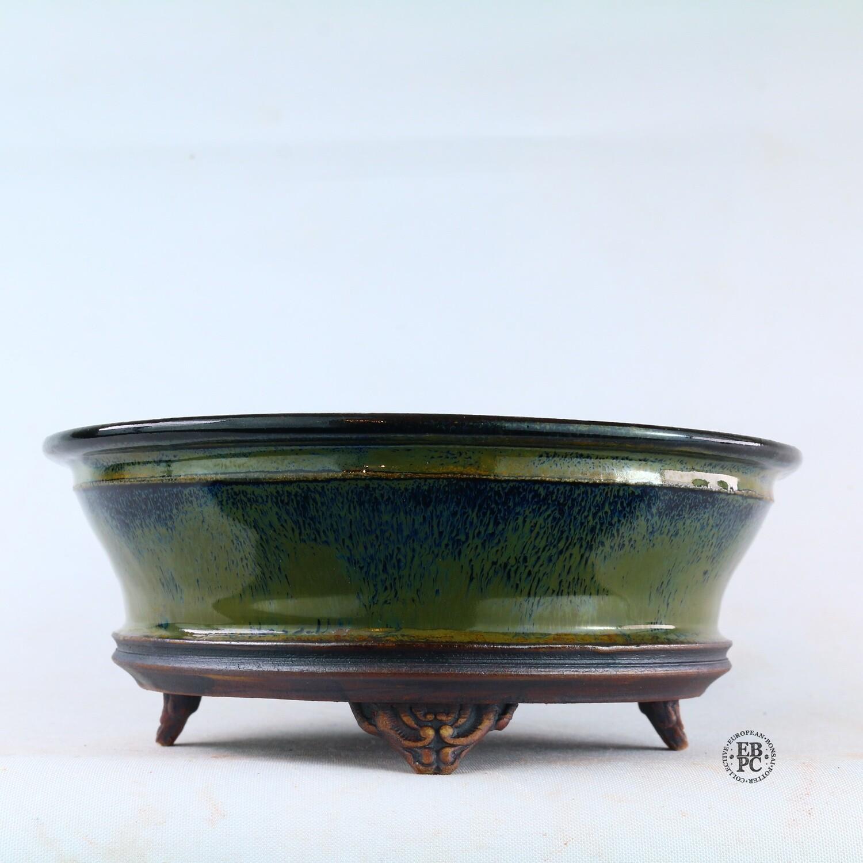 Kingdom Bonsai Pots - Ireland.  17.8cm; Round; Semi-Cascade; Banding in Relief; Carved Feet; Superb Glaze; Greens; Blues; Browns; EBPC Stamped; Enda Coyne