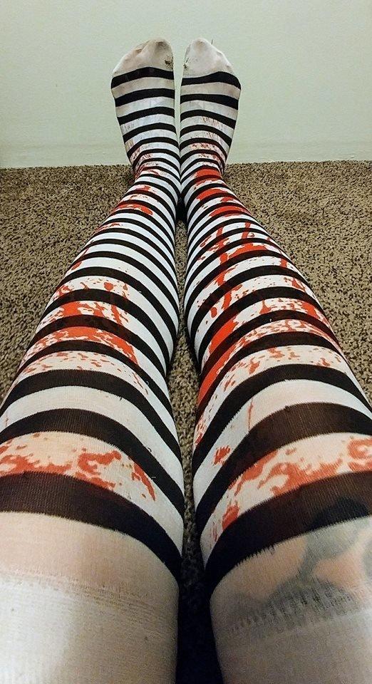 Pair of worn, knee high, black striped bloody stockings